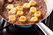 Caramelising banana slices