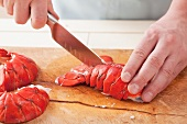 Cutting open a lobster tail lengthways