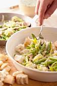 Preparing asparagus and bread bake