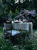 Garden table romantically set with candles and flowers