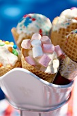 Ice cream cones filled with sweets (marshmallows and chocolate beans)
