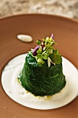Fried vegetables in aspic with cream and wild herbs