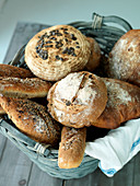 A basket of fresh bread rolls