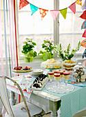 A dessert buffet on a vintage table