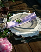 A place setting with a checked napkin