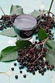 A glass of elderberry juice