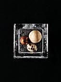 Quail egg and speckled egg on roasted, black sesame seeds
