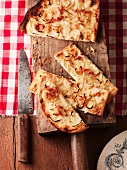 Tarte flambée with bacon and onions