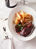 Onglet steak with onions and french fries