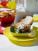 Fish burger and french fries at a summer party