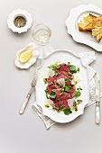 Beef carpaccio with parmesan and crostini