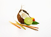 Wooden skewers, coconut, mango, Thai basil and limes