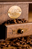 Nostalgic coffee grinder with coffee beans (close up)