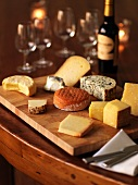 Assorted varieties of cheese and red wine