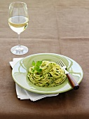 Spaghetti with parsley pesto, white wine glass