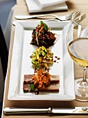 Knuckle of pork with side dishes and white wine