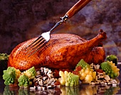 Roast duck on romanesco and wild rice