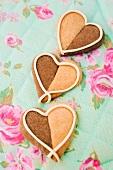 Three heart-shaped vanilla-chocolate cookies
