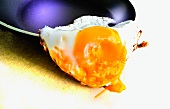 Fried eggs on the edge of a pan