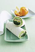 Wraps with tuna fish and corn, clementine