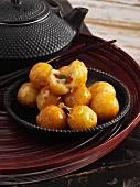 Fruity potato balls with caramel shells