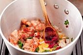 Preparing prawn sauce: sweat prawn shells