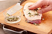 Rub the duck breast with a mixture of garlic and thyme