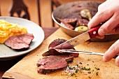 Slice the venison steak