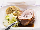 Roast pork with caraway, bread dumplings and white cabbage