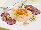 Scallop carpaccio with sliced beetroot