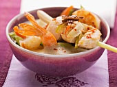 Thai coconut milk soup with prawns and a chicken and lemongrass skewer