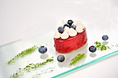 Blueberry mousse with piped cream