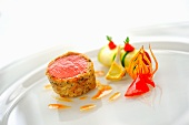 Lamb fillet in a mushroom crust with courgette ratatouille cannelloni, red artichoke and piquillo peppers