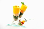 Shrimp salad with sesame and passion fruit froth in cocktail glasses