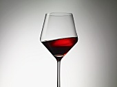 Red wine sloshing in a wine glass