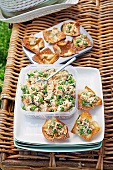 'Bites' made of wonton dough with salmon and pea filling for a picnic
