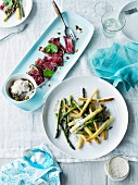 Wagyu beef carpaccio with asparagus salad