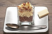 White chocolate mousse on grated chocolate
