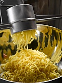 Preparing mashed potato using a potato ricer