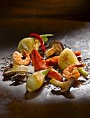 Vegetables, prawns & papaya in a wok