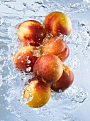 Nectarines doused in running water