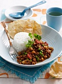 Ground beef with green peas and chick peas and a side of rice
