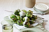 Grilled Brussels sprouts kebabs with blue cheese dip
