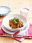 Chicken curry on a bed of rice with raita
