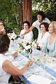 Women wine tasting in a garden
