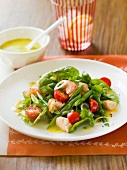 Warm salmon salad with caper dressing