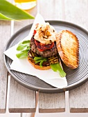 Grilled toast with burger and griddled vegetables