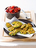 Courgette and feta fritters with tomato salad