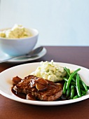 Steak in shallot and red wine sauce, green beans and mashed potato