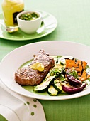 Grilled steak with vegetables and gremolata